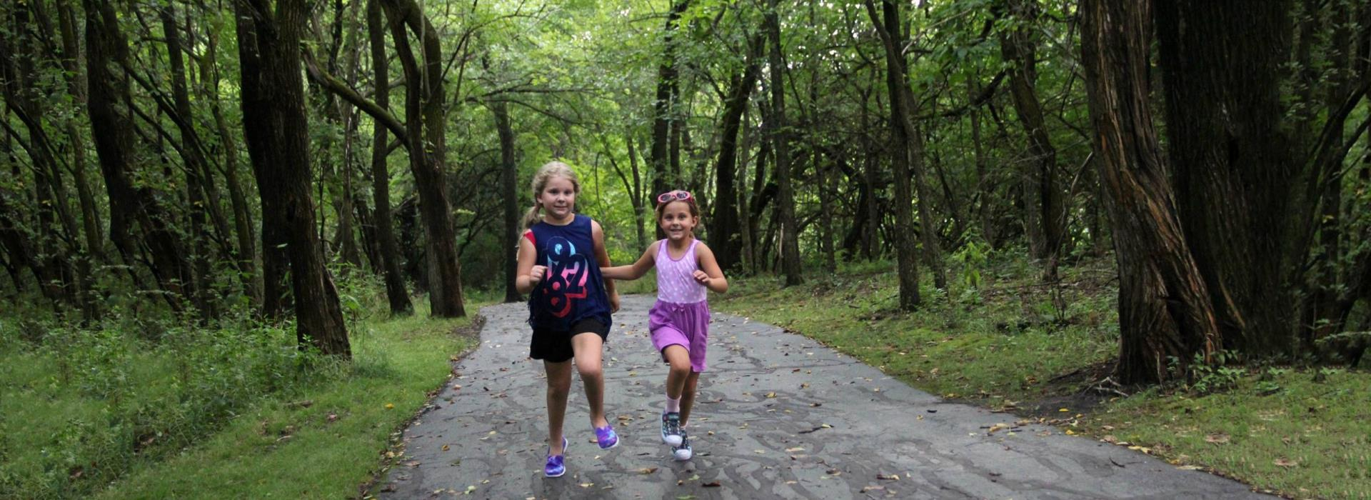 girls running on a trail