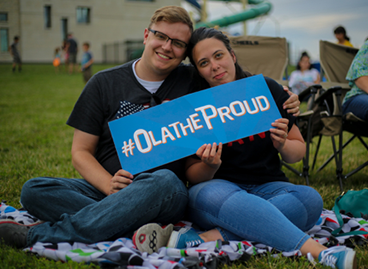 couple with olathe proud sign