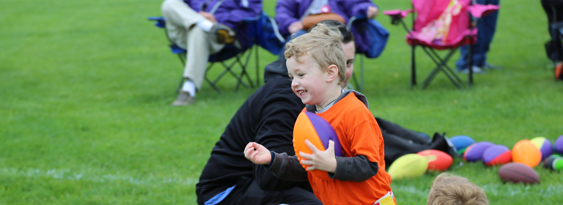 child playing flag football