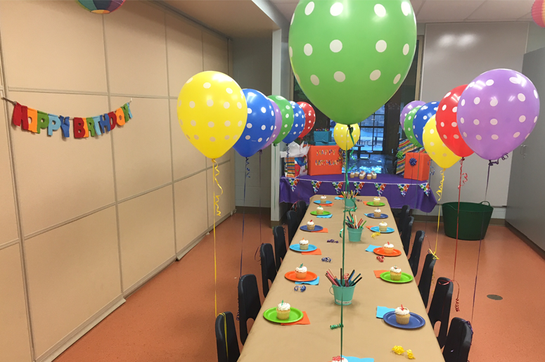 birthday party room with balloons
