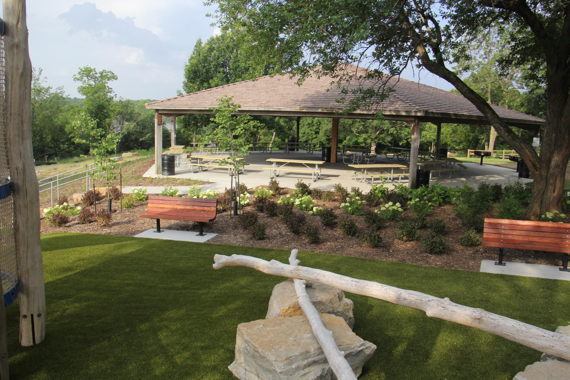 A view of the landscaping surrounding Beaver Shelter at Lake Olathe