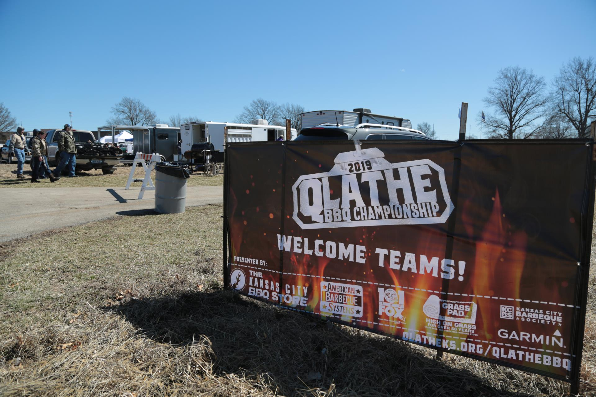 A sponsorship banner hanging at the entrance to the annual Qlathe Barbecue Competition